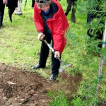 TRUP Chair Liz McDaid planting an Outeniqua yellowwood at SAAO (Photos