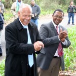 Wilmot James, MP, and Molapo Qhobela, Deputy Director General of the Department of Science and Technology enjoy tree-planting